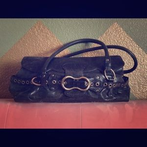 BCBGirls black leather purse with grommet/buckle